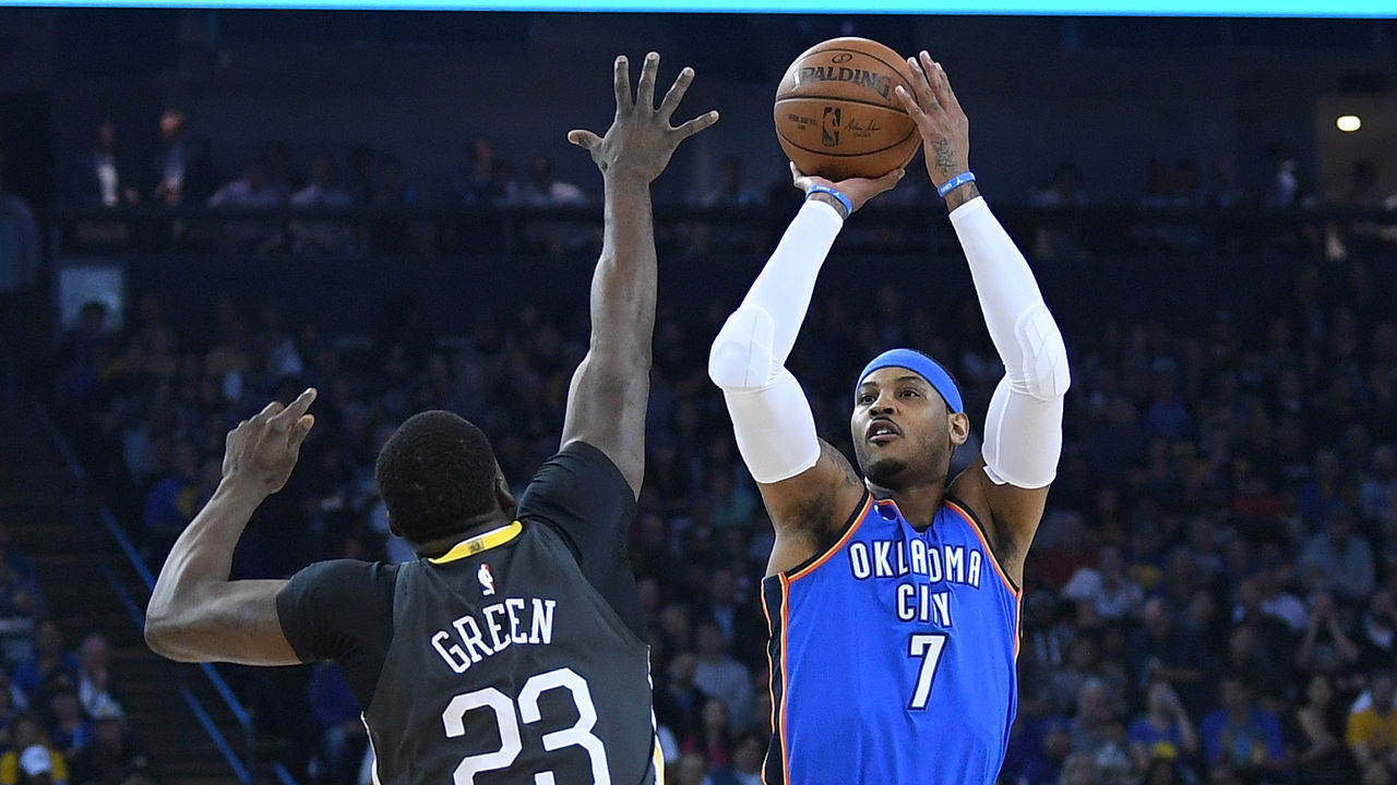 OAKLAND, CA - FEBRUARY 06: Carmelo Anthony #7 of the Oklahoma City Thunder shoots over Draymond Green #23 of the Golden State Warriors during the first half of their NBA basketball game at ORACLE Arena on February 6, 2018 in Oakland, California.