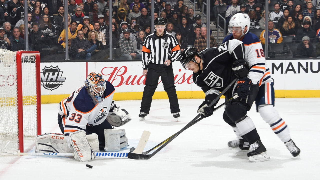 LOS ANGELES, CA - FEBRUARY 24: Dustin Brown #23 of the Los Angeles Kings looks to shoot the puck against Cam Talbot #33 of the Edmonton Oilers at STAPLES Center on February 24, 2018 in Los Angeles, California.