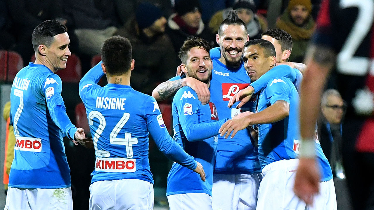 Napoli's Slovakian midfielder Marek Hamsik (2ndR) celebrates with teammates after scoring a goal during the Italian Serie A football match between Cagliari and Napoli at Sardinia stadium in Cagliari on February 26, 2018. / AFP PHOTO / ALBERTO PIZZOLI