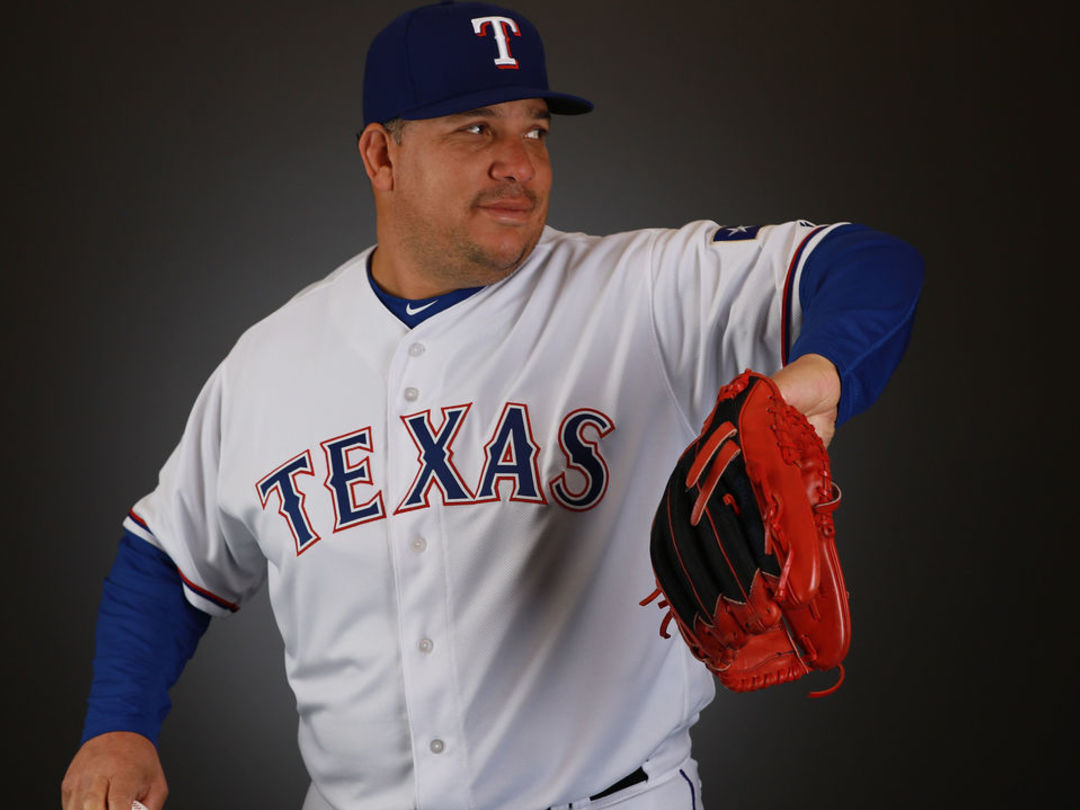 Colon glad to be with Rangers so he doesn't have to 'hit or run'