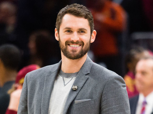 CLEVELAND, OH - FEBRUARY 3: Kevin Love #0 of the Cleveland Cavaliers talks to players on the Houston Rockets bench during a time-out during the second half at Quicken Loans Arena on February 3, 2018 in Cleveland, Ohio. The Rockets defeated the Cavaliers 120-88.