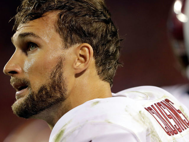 KANSAS CITY, MO - OCTOBER 02: Quarterback Kirk Cousins #8 of the Washington Redskins looks up at the scoreboard during the 4th quarter of the game against the Kansas City Chiefs at Arrowhead Stadium on October 2, 2017 in Kansas City, Missouri.