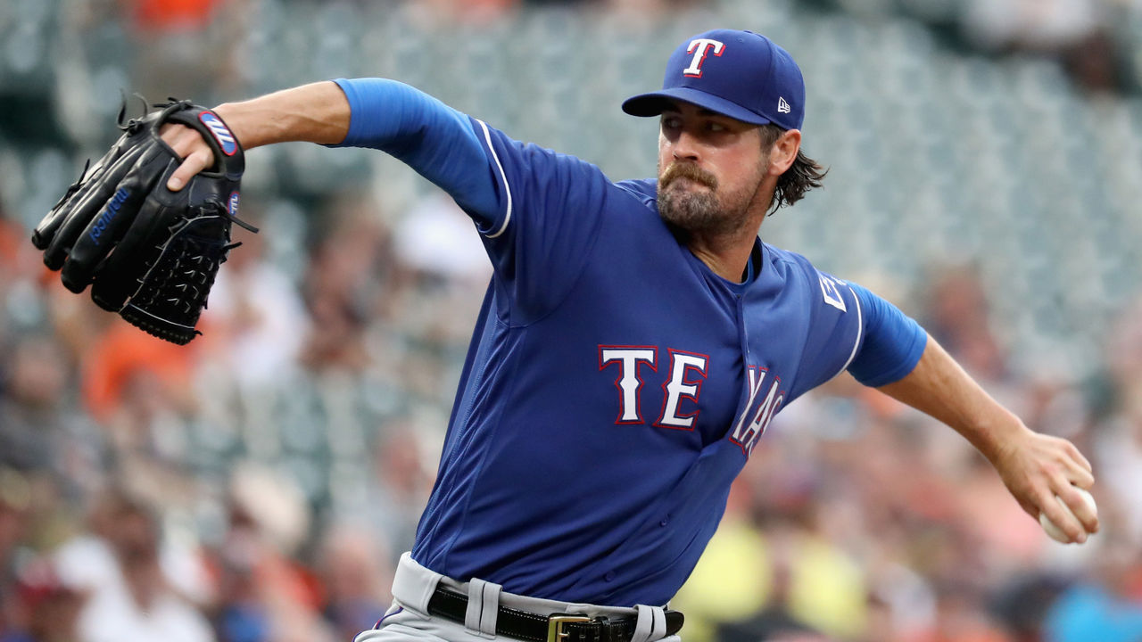 BALTIMORE, MD - JULY 20: Starting pitcher Cole Hamels #35 of the Texas Rangers throws to a Baltimore Orioles batter in the second inning at Oriole Park at Camden Yards on July 20, 2017 in Baltimore, Maryland.