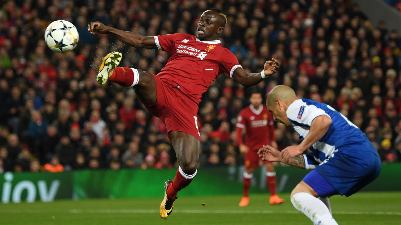 LIVERPOOL, ENGLAND - MARCH 06: Sadio Mane of Liverpool stretches for the ball while under pressure from Maximiliano of FC Porto during the UEFA Champions League Round of 16 Second Leg match between Liverpool and FC Porto at Anfield on March 6, 2018 in Liverpool, United Kingdom.