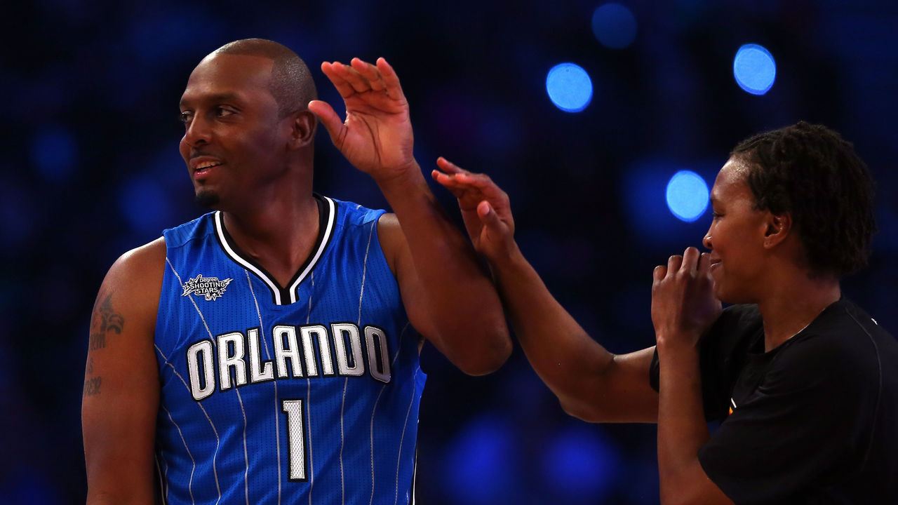NEW YORK, NY - FEBRUARY 14: NBA Legend Anfernee 'Penny' Hardaway high fives Tamika Catchings of the Indiana Fever during the Degree Shooting Stars Competition as part of the 2015 NBA Allstar Weekend at Barclays Center on February 14, 2015 in the Brooklyn borough of New York City.