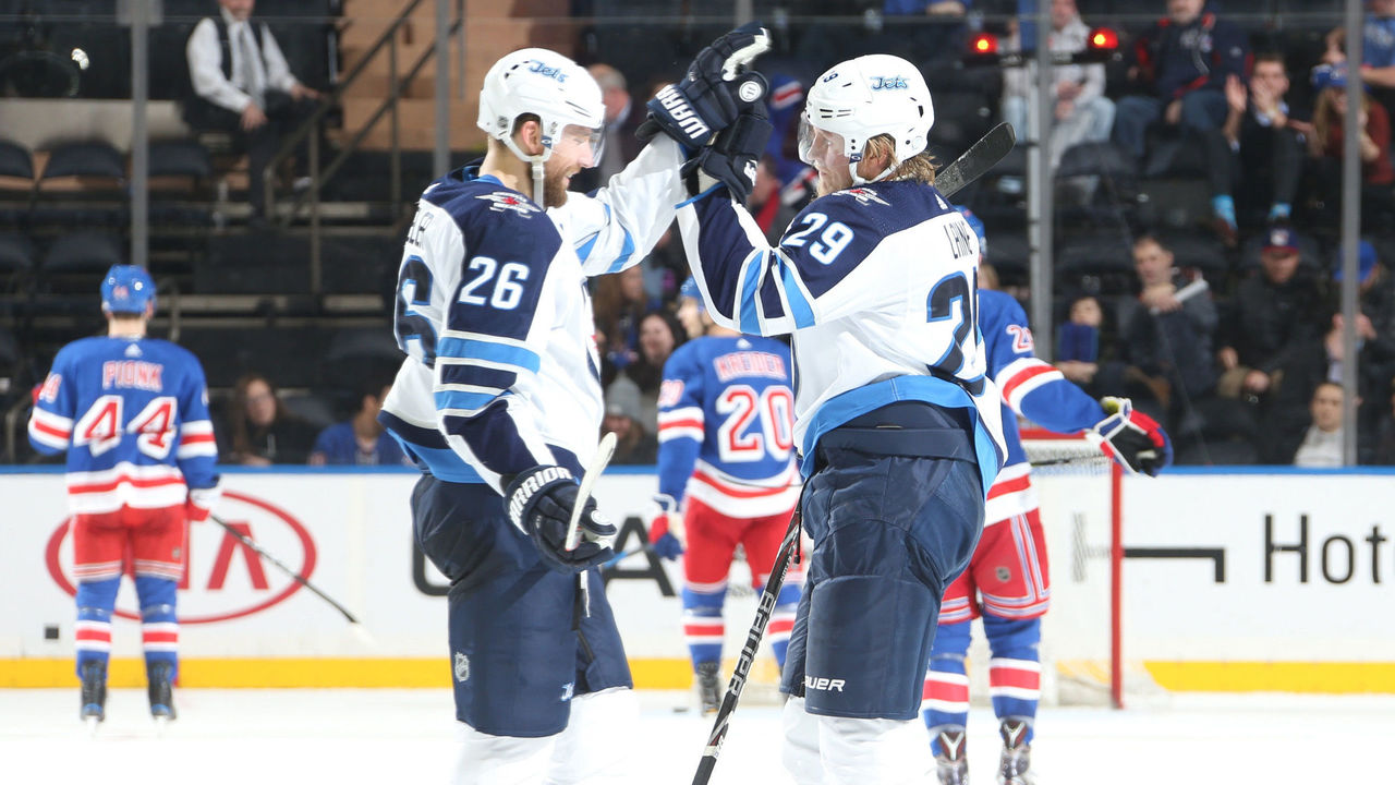 NEW YORK, NY - MARCH 06: Patrik Laine #29 of the Winnipeg Jets celebrates after scoring his third goal of the game in the third period against the New York Rangers at Madison Square Garden on March 6, 2018 in New York City.