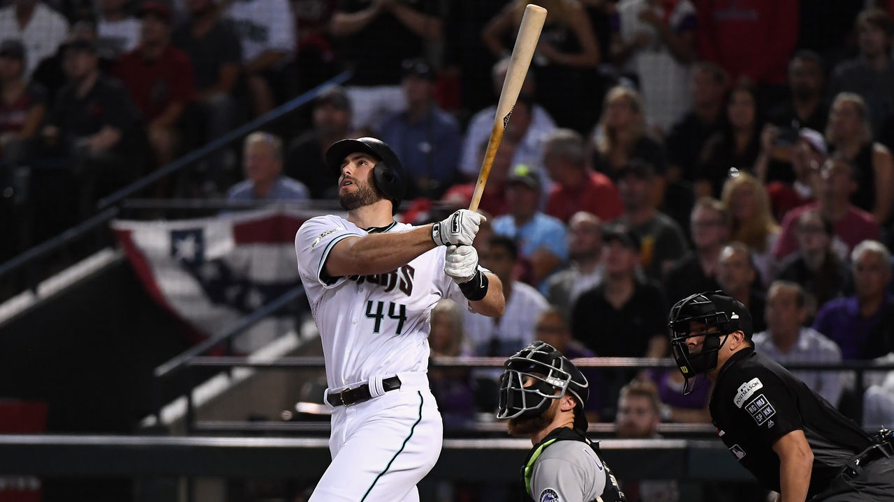 PHOENIX, AZ - OCTOBER 04: Paul Goldschmidt #44 of the Arizona Diamondbacks watches hits a three run home run during the bottom of the first inning of the National League Wild Card game against the Colorado Rockies at Chase Field on October 4, 2017 in Phoenix, Arizona.