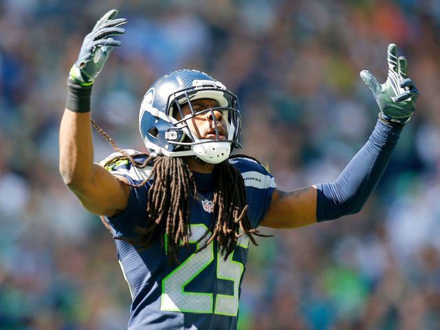 SEATTLE, WA - SEPTEMBER 11: Cornerback Richard Sherman #25 of the Seattle Seahawks gets the crowd going against the Miami Dolphins in the first half at CenturyLink Field on September 11, 2016 in Seattle, Washington.