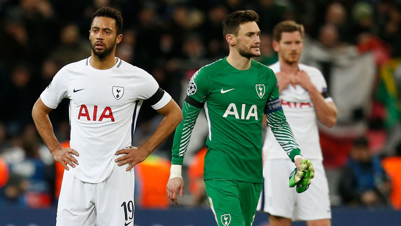 Tottenham Hotspur's Belgian midfielder Mousa Dembele (L), Tottenham Hotspur's French goalkeeper Hugo Lloris (2nd L), Tottenham Hotspur's Belgian defender Jan Vertonghen and Tottenham Hotspur's Danish midfielder Christian Eriksen (R) react to their defeat on the pitch after the UEFA Champions League round of sixteen second leg football match between Tottenham Hotspur and Juventus at Wembley Stadium in London, on March 7, 2018. Juventus staged a stunning fightback against Tottenham to reach the Champions League quarter-finals 4-3 on aggregate after Paulo Dybala sealed a dramatic 2-1 win in the last 16, second leg on Wednesday. / AFP PHOTO / IKIMAGES / Ian KINGTON
