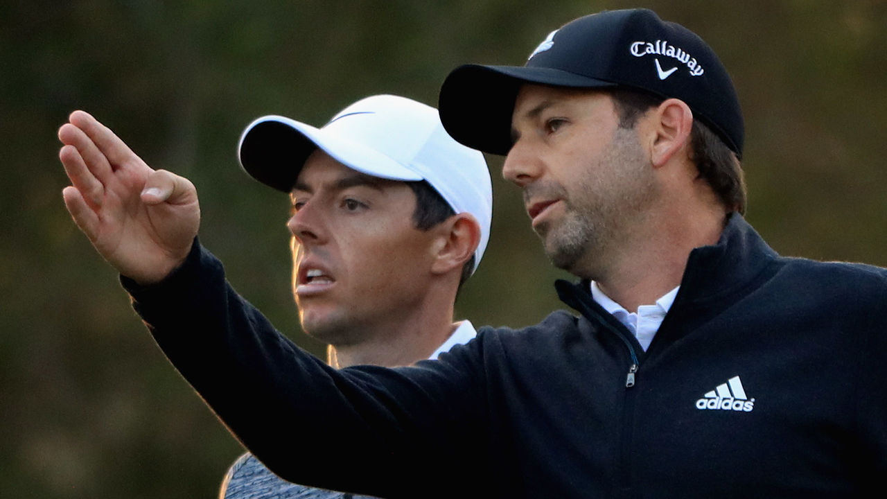 DUBAI, UNITED ARAB EMIRATES - JANUARY 27: (L-R) Rory McIlroy of Northern Ireland and Sergio Garcia of Spain walk together on the 12th hole during the completion of the second round of the Omega Dubai Desert Classic at Emirates Golf Club on January 27, 2018 in Dubai, United Arab Emirates.