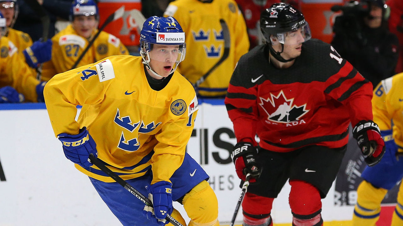 BUFFALO, NY - JANUARY 5: Elias Pettersson #14 of Sweden in play against Canada during the Gold medal game of the IIHF World Junior Championship at KeyBank Center on January 5, 2018 in Buffalo, New York. Canada beat Sweden 3-1.