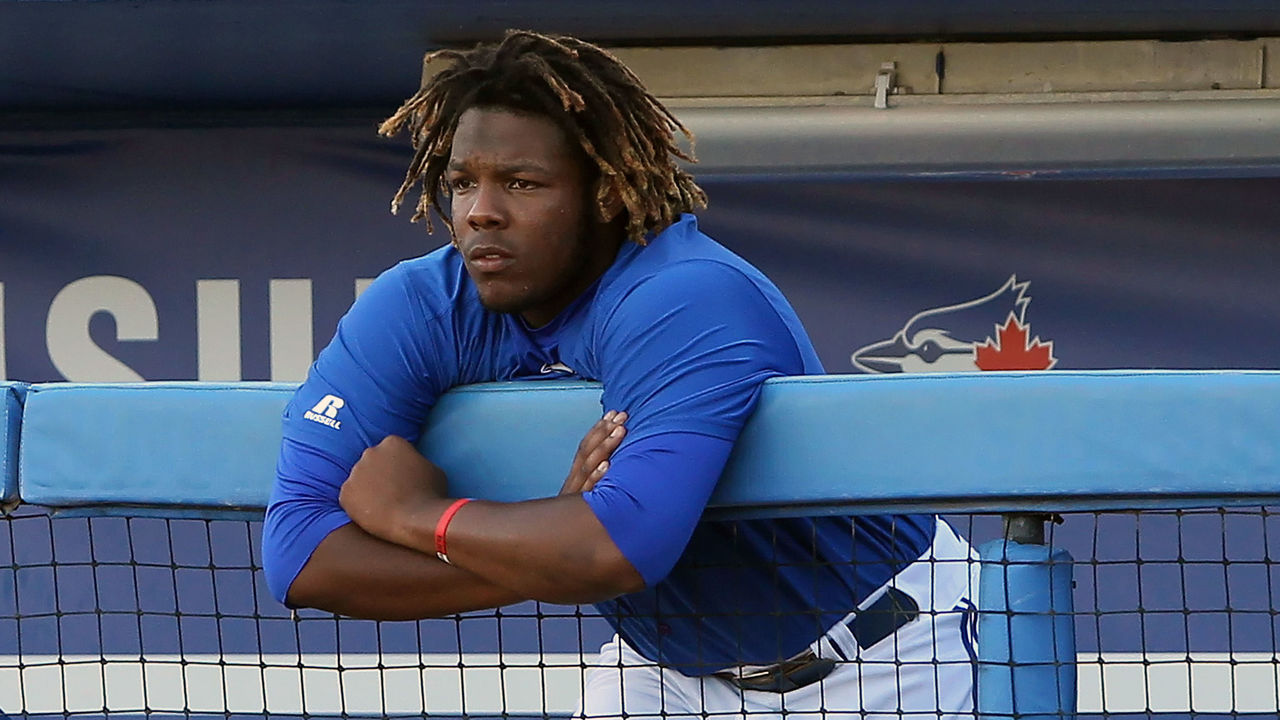 TAMPA, FL - AUG 14: Vladimir Guerrero Jr. (27) of the Blue Jays watches the action from the top step of the dugout during the Florida State League game between the Palm Beach Cardinals and the Dunedin Blue Jays on August 14, 2017, at Florida Auto Exchange Stadium in Dunedin, FL.