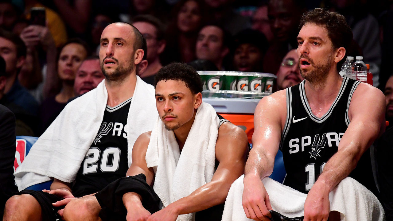 LOS ANGELES, CA - JANUARY 11: (L-R) Manu Ginobili #20, Bryn Forbes #11 and Pau Gasol #16 of the San Antonio Spurs watch during a 93-81 Los Angeles Laker win at Staples Center on January 11, 2018 in Los Angeles, California.