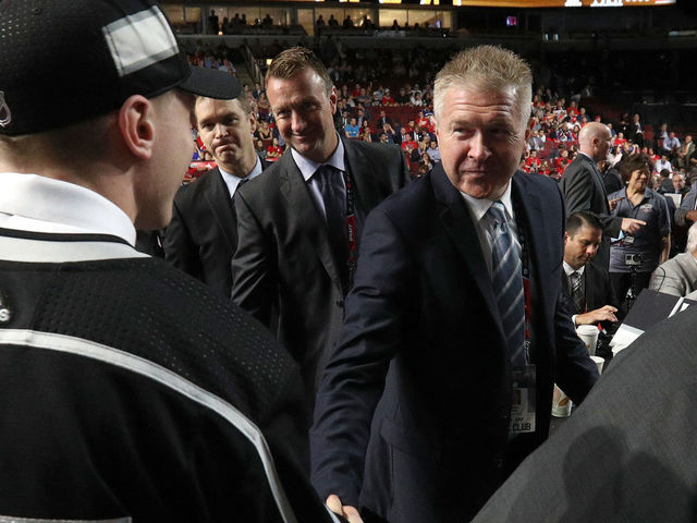 CHICAGO, IL - JUNE 24: Jaret Anderson-Dolan, 41st overall pick of the Los Angeles Kings, shakes the hand of assistant general manager Mike Futa of the Los Angeles Kings during the 2017 NHL Draft at United Center on June 24, 2017 in Chicago, Illinois.