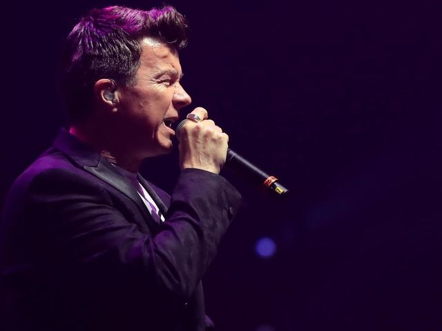 British singer songwriter Rick Astley performs during the 'We Are Manchester' charity concert at the Manchester Arena in Manchester, northwest England, on September 9, 2017 held to honour those affected by the May 22 Manchester Arena bombing. Thousands of music fans cheered the names of those killed in the May 22 Manchester Arena terror attack as the venue re-opened for the first time with a charity concert. The event was held to honour those affected by the bomding and to raise money for a permanent memorial for the 22 victims killed when suicide bomber Salman Abedi detonated a device in the arena foyer at the end of an Ariana Grande concert on May 22. / AFP PHOTO / POOL / Peter Byrne / RESTRICTED TO EDITORIAL USE -NO MARKETING NO ADVERTISING CAMPAIGNS NO COMMERCIAL USE