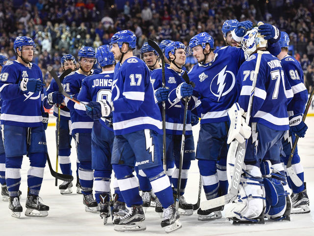 TAMPA, FL - MARCH 10: The Lightning congratulate Tampa Bay Lightning goalie Louis Domingue (70) for a shootout victory during an NHL game between the Montreal Canadiens and the Tampa Bay Lightning on March 10, 2018, at Amalie Arena in Tampa, FL.