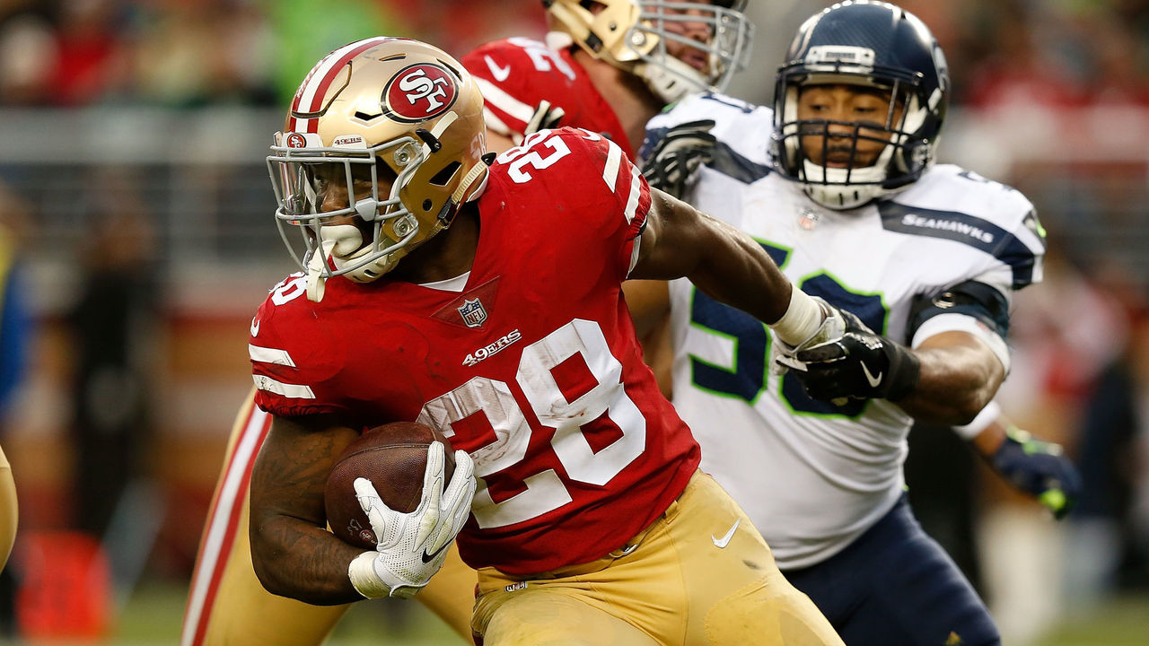 SANTA CLARA, CA - NOVEMBER 26: Carlos Hyde #28 of the San Francisco 49ers is tackled by K.J. Wright #50 of the Seattle Seahawks at Levi's Stadium on November 26, 2017 in Santa Clara, California.