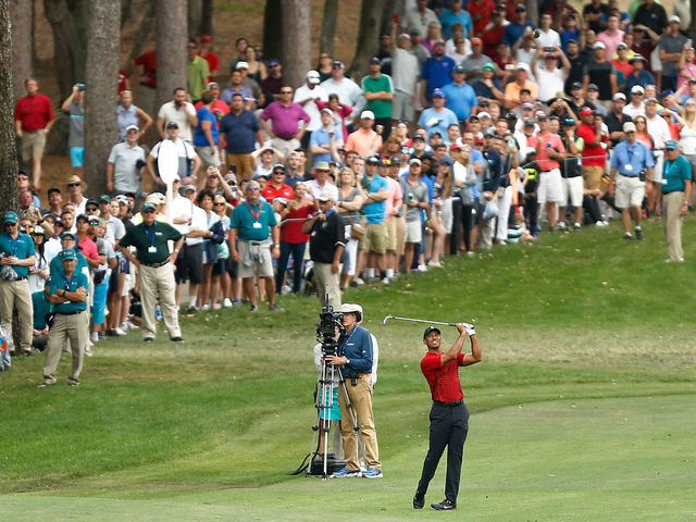PALM HARBOR, FL - MARCH 11: Tiger Woods plays his second shot on the 18th hole during the final round of the Valspar Championship at Innisbrook Resort Copperhead Course on March 11, 2018 in Palm Harbor, Florida.