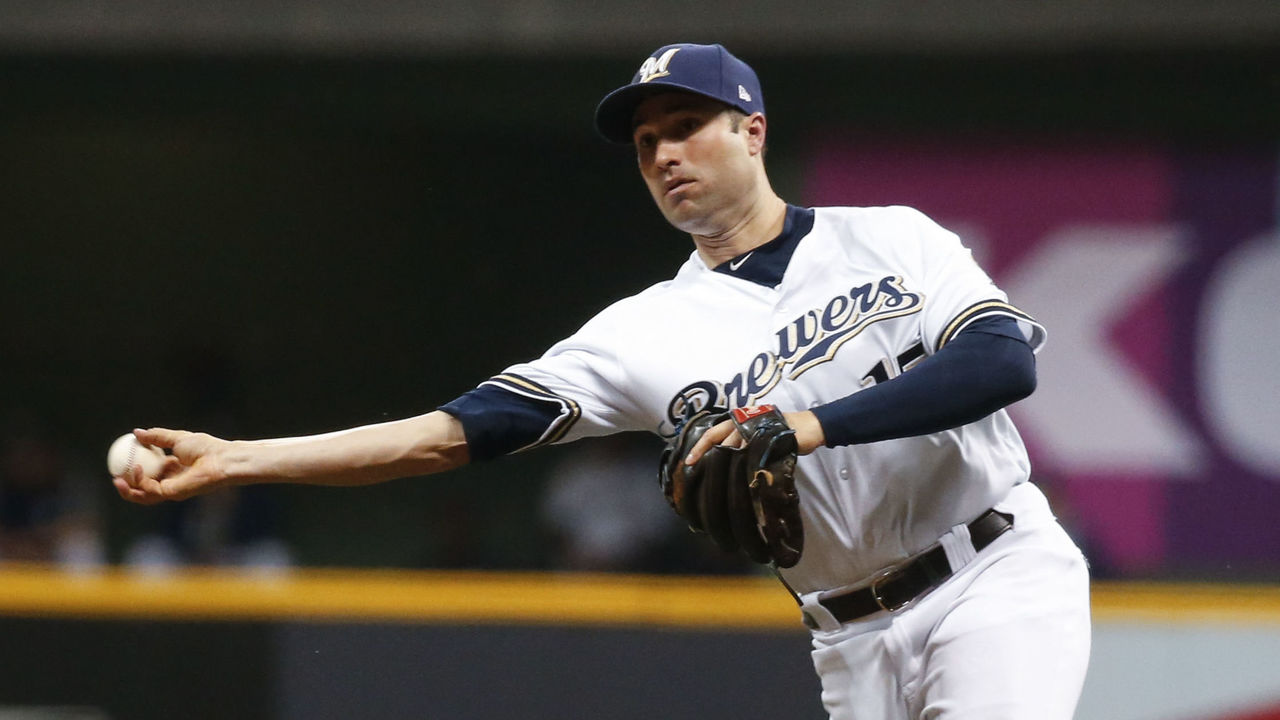 MILWAUKEE, WI - SEPTEMBER 16: Neil Walker #15 of the Milwaukee Brewers throws out J.T. Realmuto #11 (not pictured) of the Miami Marlins during the seventh inning at Miller Park on September 16, 2017 in Milwaukee, Wisconsin. The Marlins defeated the Brewers 7-4.