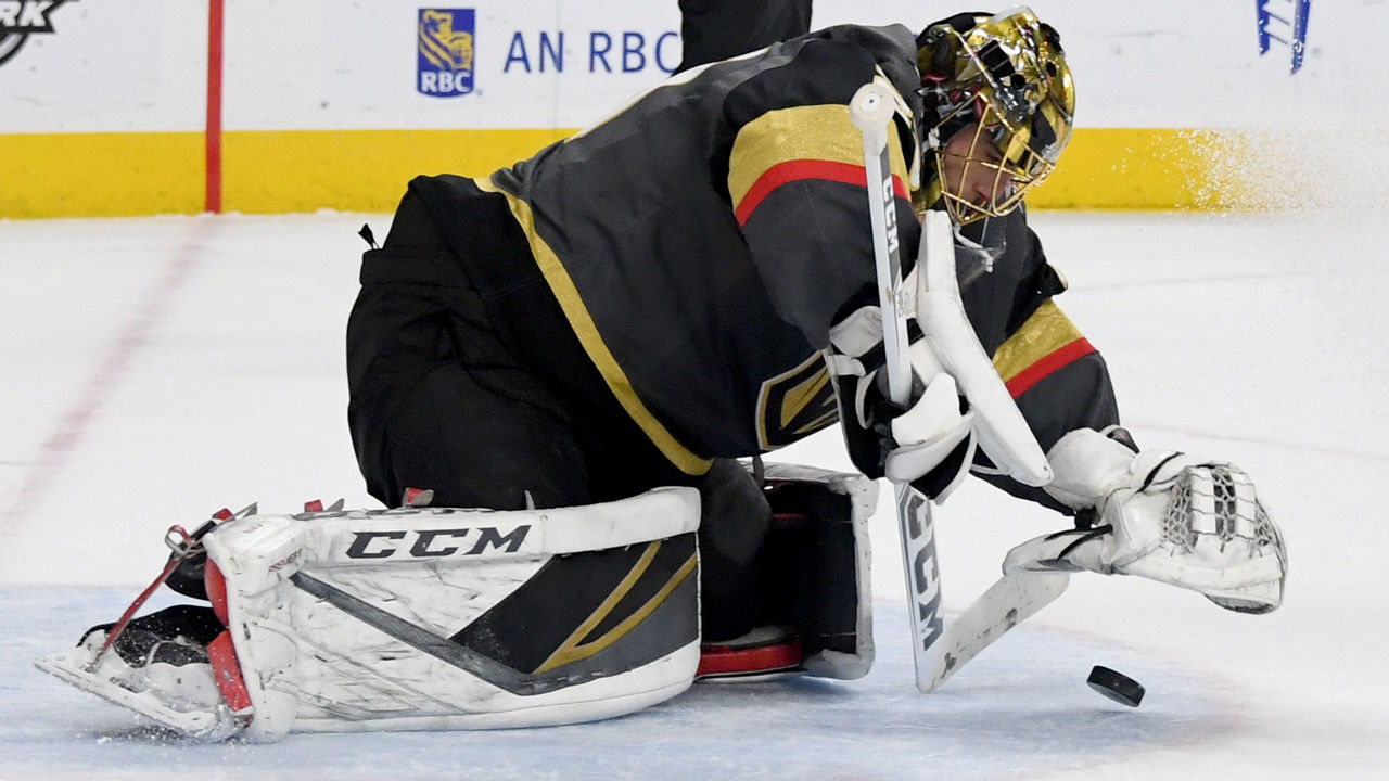 LAS VEGAS, NV - JANUARY 23: Marc-Andre Fleury #29 of the Vegas Golden Knights covers the puck to stop a shot by the Columbus Blue Jackets in the first period of their game at T-Mobile Arena on January 23, 2018 in Las Vegas, Nevada.