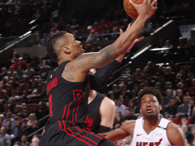 PORTLAND, OR - MARCH 12: Damian Lillard #0 of the Portland Trail Blazers goes to the basket against the Miami Heat on March 12, 2018 at the Moda Center in Portland, Oregon. Mandatory Copyright Notice: Copyright 2018 NBAE