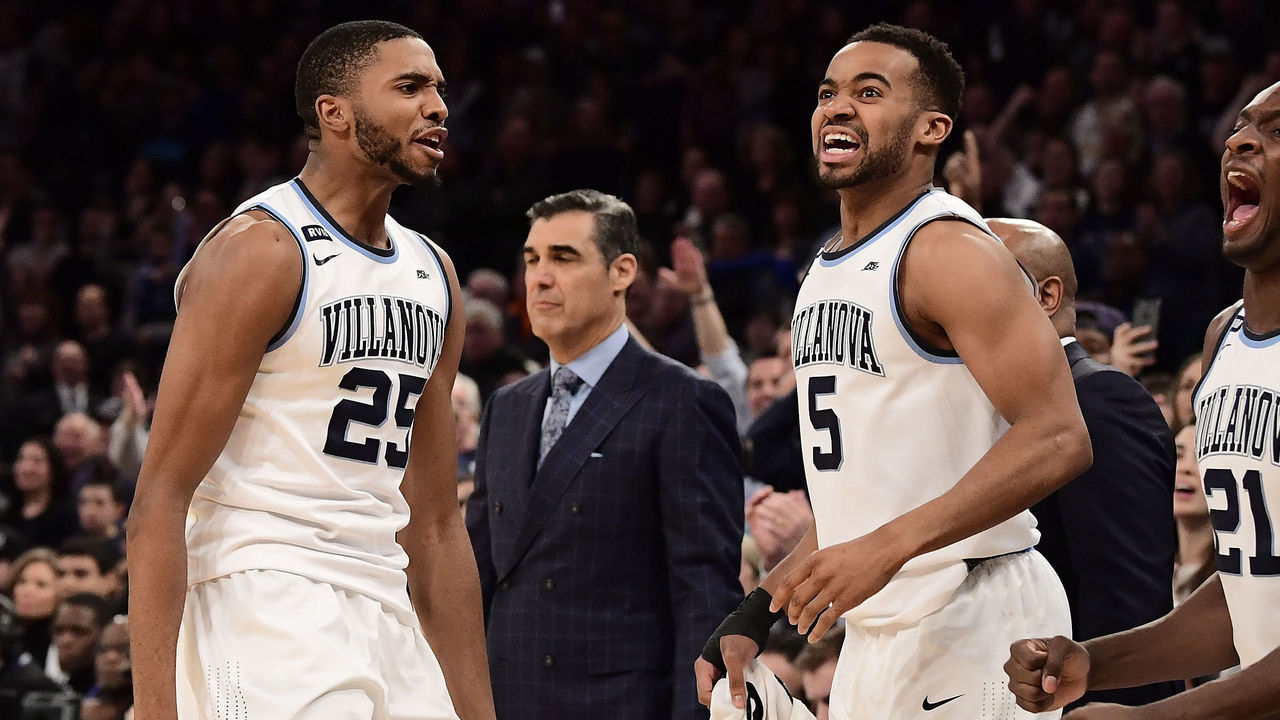 NEW YORK, NY - MARCH 10: Mikal Bridges #25 and Phil Booth #5 of the Villanova Wildcats celebrate their teams lead late in the game against the Providence Friars during the championship game of the Big East Basketball Tournament at Madison Square Garden on March 10, 2018 in New York City.