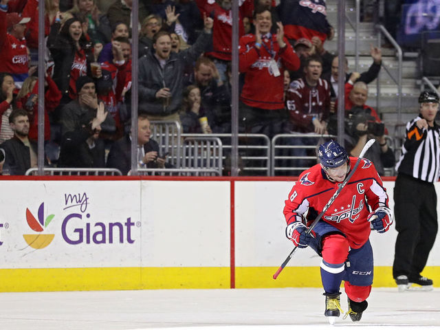 WASHINGTON, DC - MARCH 12: Alex Ovechkin #8 of the Washington Capitals celebrates after scoring his 599th career goal against the Winnipeg Jets during the first period at Capital One Arena on March 12, 2018 in Washington, DC.