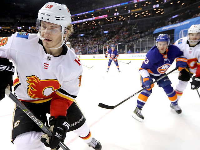 NEW YORK, NY - FEBRUARY 11: Matthew Tkachuk #19 of the Calgary Flames skates towards the puck in the first period against the New York Islanders during their game at Barclays Center on February 11, 2018 in the Brooklyn borough of New York City.