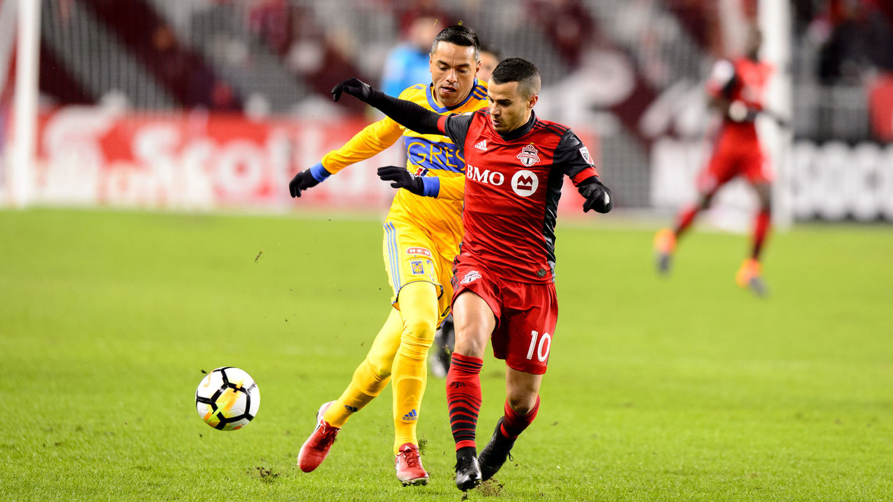 TORONTO, ON - MARCH 07: Juninho (3) of Tigres UANL attempts to stop Sebastian Giovinco (10) of Toronto FC during the first half of the CONCACAF Champions League Quarter-final match between Toronto FC and Tigres UANL on March 7, 2018, at BMO Field in Toronto, ON, Canada. (Photograph by Julian Avram/Icon Sportswire via Getty Images)