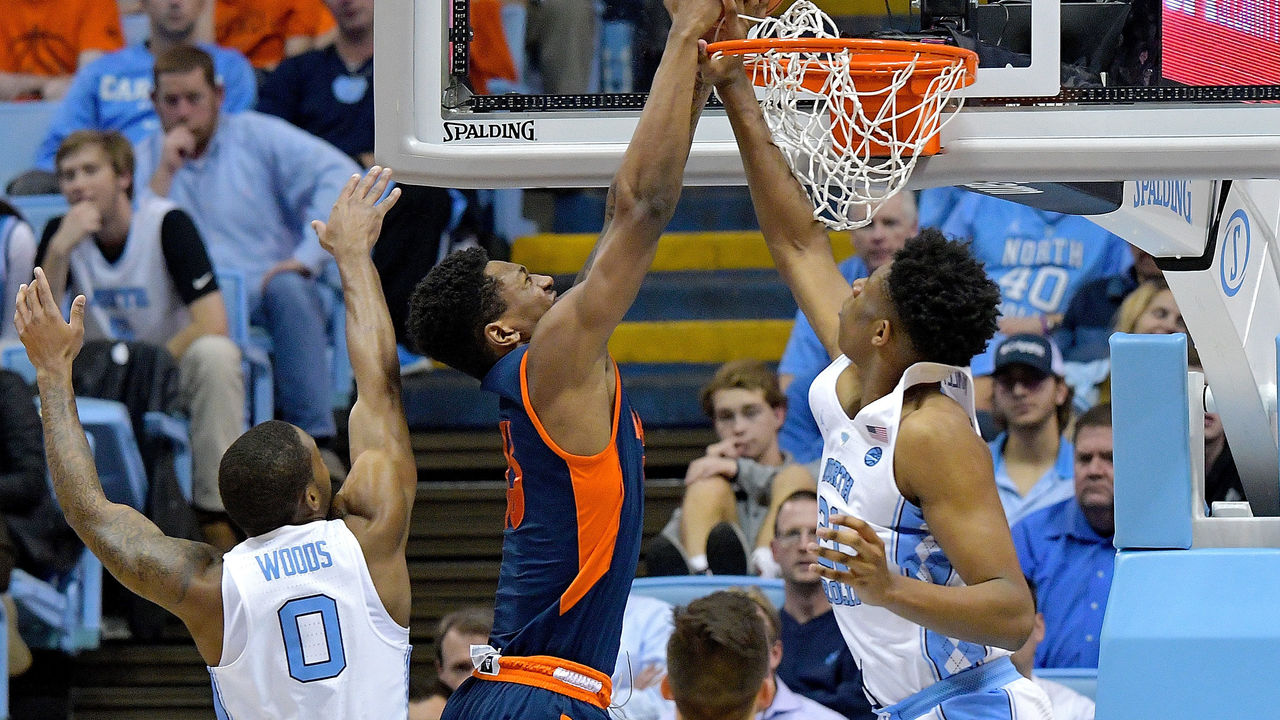 CHAPEL HILL, NC - NOVEMBER 15: Sterling Manley #21 of the North Carolina Tar Heels defends a shot by Bruce Moore #13 of the Bucknell Bison during their game at the Dean Smith Center on November 15, 2017 in Chapel Hill, North Carolina. North Carolina won 93-81.