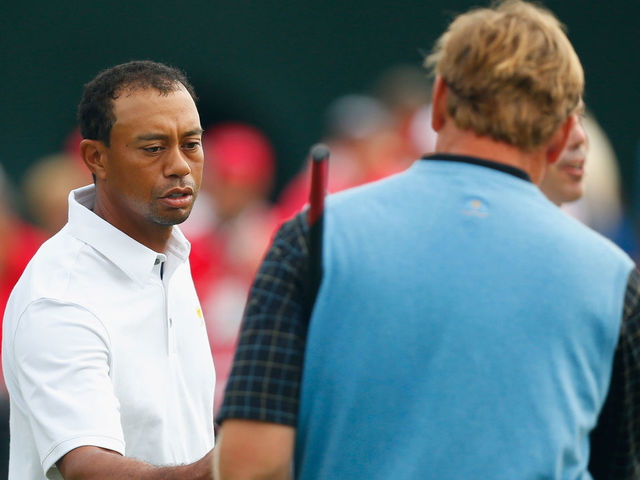 DUBLIN, OH - OCTOBER 06: Ernie Els of South Africa and the International Team shakes hands with Tiger Woods of the U.S. Team after their weather-delayed Day Three Foursome Match at the Muirfield Village Golf Club on October 6, 2013 in Dublin, Ohio.