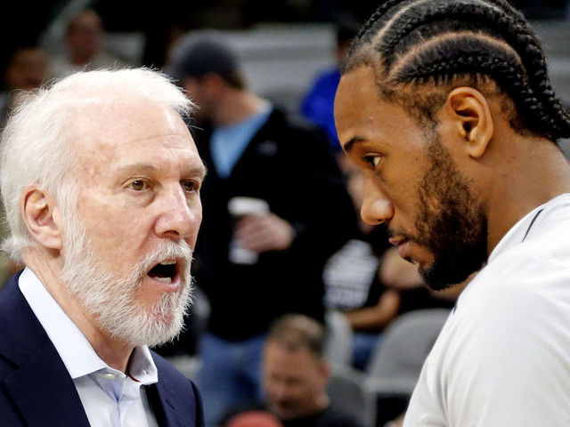 SAN ANTONIO,TX - DECEMBER 18 : Kawhi Leonard #2 of the San Antonio Spurs chats with head coach Gregg Popovich before the start of their game against the Los Angeles Clippers at AT&T Center on December 18, 2017 in San Antonio, Texas. NOTE TO USER: User expressly acknowledges and agrees that , by downloading and or using this photograph, User is consenting to the terms and conditions of the Getty Images License Agreement.