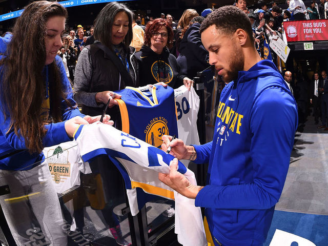 OAKLAND, CA - MARCH 8: Stephen Curry #30 of the Golden State Warriors signs autographs for fans before the game against the San Antonio Spurs on March 8, 2018 at ORACLE Arena in Oakland, California. NOTE TO USER: User expressly acknowledges and agrees that, by downloading and or using this photograph, user is consenting to the terms and conditions of Getty Images License Agreement. Mandatory Copyright Notice: Copyright 2018 NBAE
