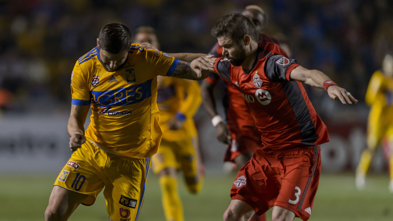 MONTERREY, MEXICO - MARCH 13: Andre-Pierre Gignac of Tigres fights for the ball with Drew Moor of Toronto during the quarterfinals second leg match between Tigres UANL and Toronto FC as part of the CONCACAF Champions League 2018 at Universitario Stadium on March 13, 2018 in Monterrey, Mexico.