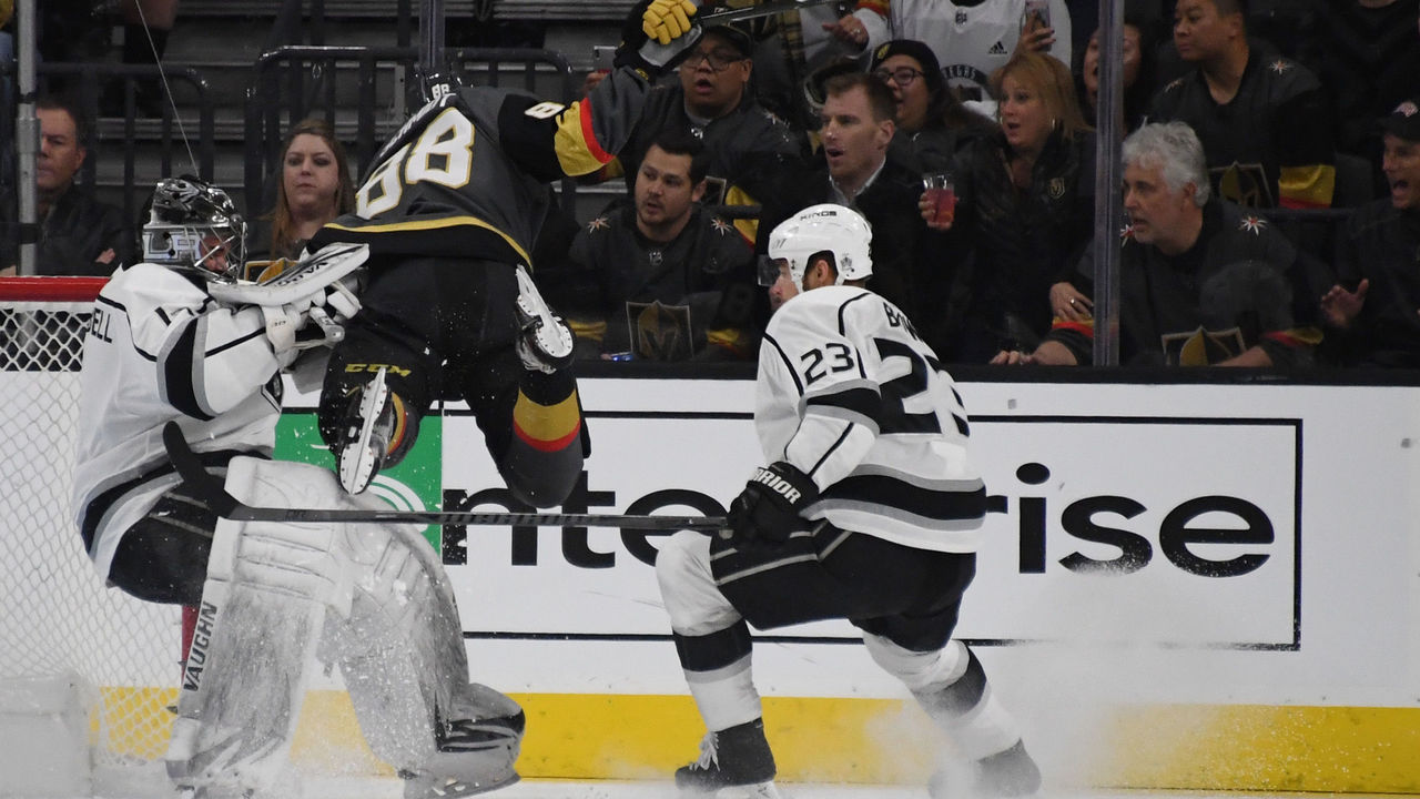 LAS VEGAS, NV - FEBRUARY 27: Nate Schmidt #88 of the Vegas Golden Knights crashes into Jack Campbell #1 of the Los Angeles Kings as Dustin Brown #23 of the Kings looks on in the first period of their game at T-Mobile Arena on February 27, 2018 in Las Vegas, Nevada. Schmidt recieved a two-minute minor penalty for interference on the play.