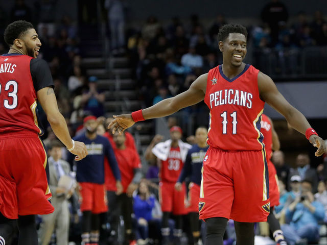 CHARLOTTE, NC - MARCH 11: Teammates Jrue Holiday #11 and Anthony Davis #23 of the New Orleans Pelicans react after a play during their game against the Charlotte Hornets at Spectrum Center on March 11, 2017 in Charlotte, North Carolina.