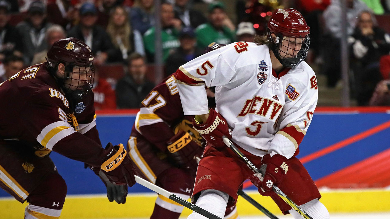 CHICAGO, IL - APRIL 08: Henrik Borgstrom #5 of the Denver Pioneers is pressure by Nick Wolff #5 of the Minnesota-Duluth Bulldogs during the 2017 NCAA Division I Men's Ice Hockey Championship game at the United Center on April 8, 2017 in Chicago, Illinois. Denver defeated Minnesota-Duluth 3-2.
