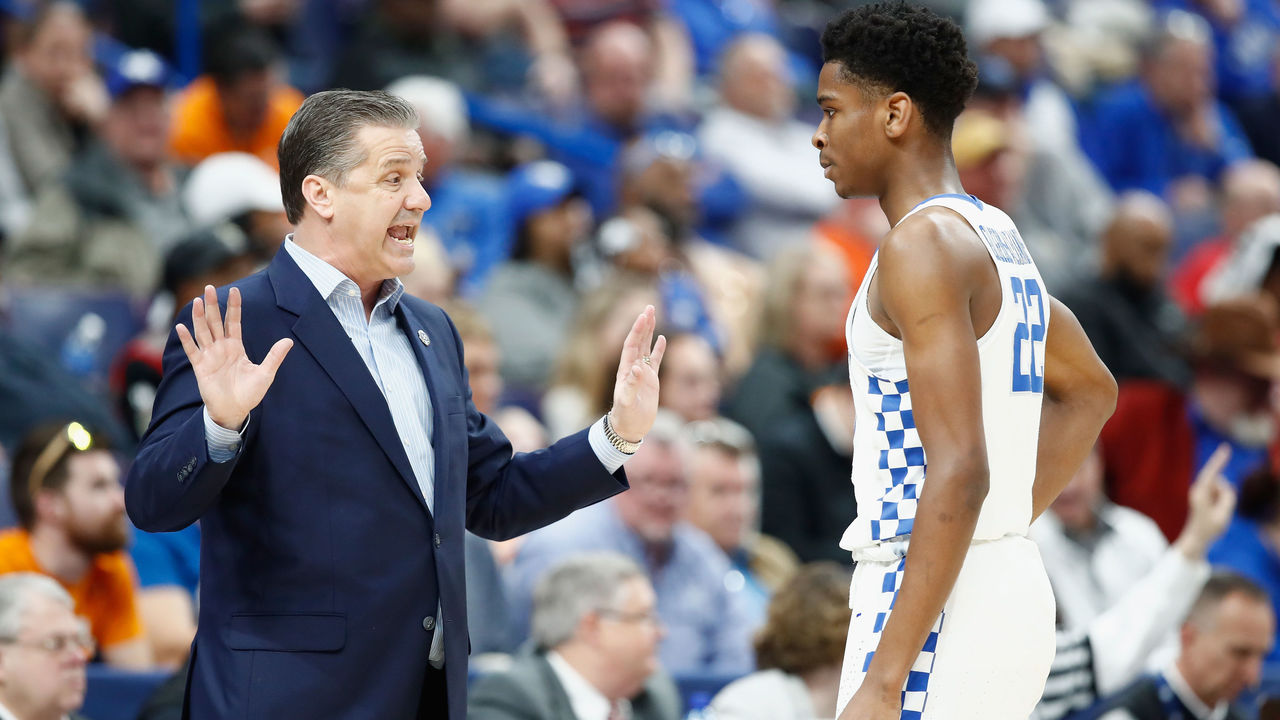ST LOUIS, MO - MARCH 09: John Calipari the head coach of the Kentucky Wildcats gives instructions to Shai Gilgeous-Alexander #22 during the game against the Georgia Bulldogs during the quarterfinals round of the 2018 SEC Basketball Tournament at Scottrade Center on March 9, 2018 in St Louis, Missouri.