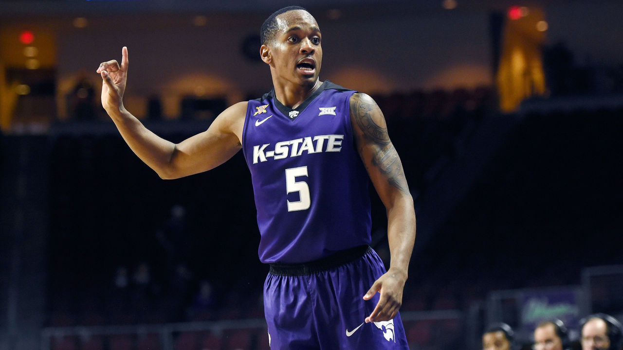 LAS VEGAS, NV - NOVEMBER 24: Barry Brown Jr. #5 of the Kansas State Wildcats signals against the George Washington Colonials during the 2017 Continental Tire Las Vegas Invitational basketball tournament at the Orleans Arena on November 24, 2017 in Las Vegas, Nevada. Kansas State won 67-59.