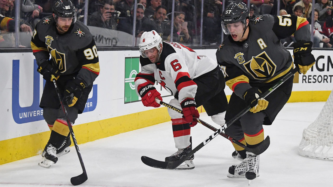 LAS VEGAS, NV - MARCH 14: Tomas Tatar #90 of the Vegas Golden Knights, Andy Greene #6 of the New Jersey Devils and David Perron #57 of the Golden Knights chase the puck in the second period of their game at T-Mobile Arena on March 14, 2018 in Las Vegas, Nevada.
