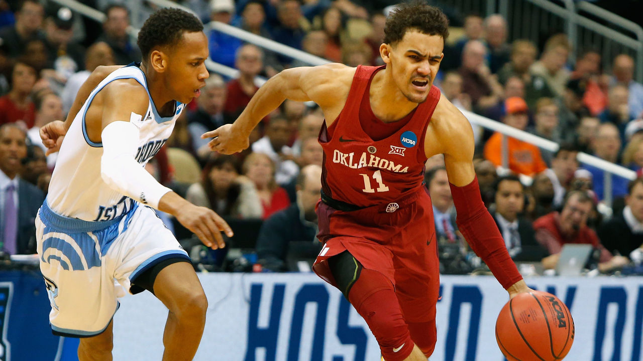 PITTSBURGH, PA - MARCH 15: Trae Young #11 of the Oklahoma Sooners is defended by Fatts Russell #2 of the Rhode Island Rams in the first half of the game during the first round of the 2018 NCAA Men's Basketball Tournament at PPG PAINTS Arena on March 15, 2018 in Pittsburgh, Pennsylvania.