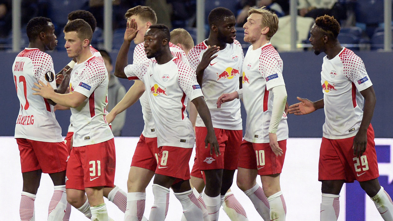 Leipzig's players celebrate a goal scored by Jean-Kevin Augustin during the UEFA Europa League Round of 16 second leg football match between FC Zenit and RB Leipzig on March 15, 2018 in Saint Petersburg. / AFP PHOTO / Olga MALTSEVA