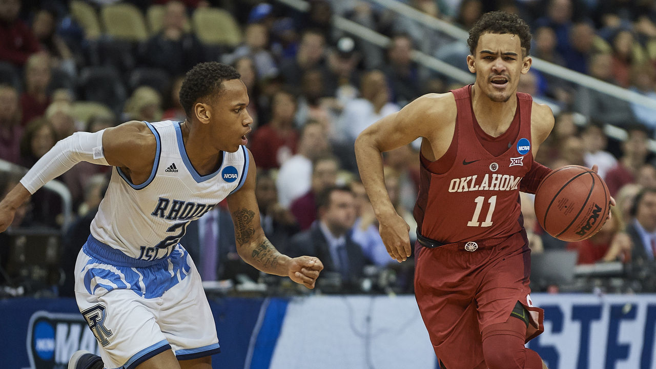 PITTSBURGH, PA - MARCH 15: Oklahoma Sooners guard Trae Young (11) drives the ball during the first half of the first round of the NCAA Division I Men's Championships between the Rhode Island Rams and the Oklahoma Sooners at PPG Paints Arena in Pittsburgh, PA on March 15, 2018.