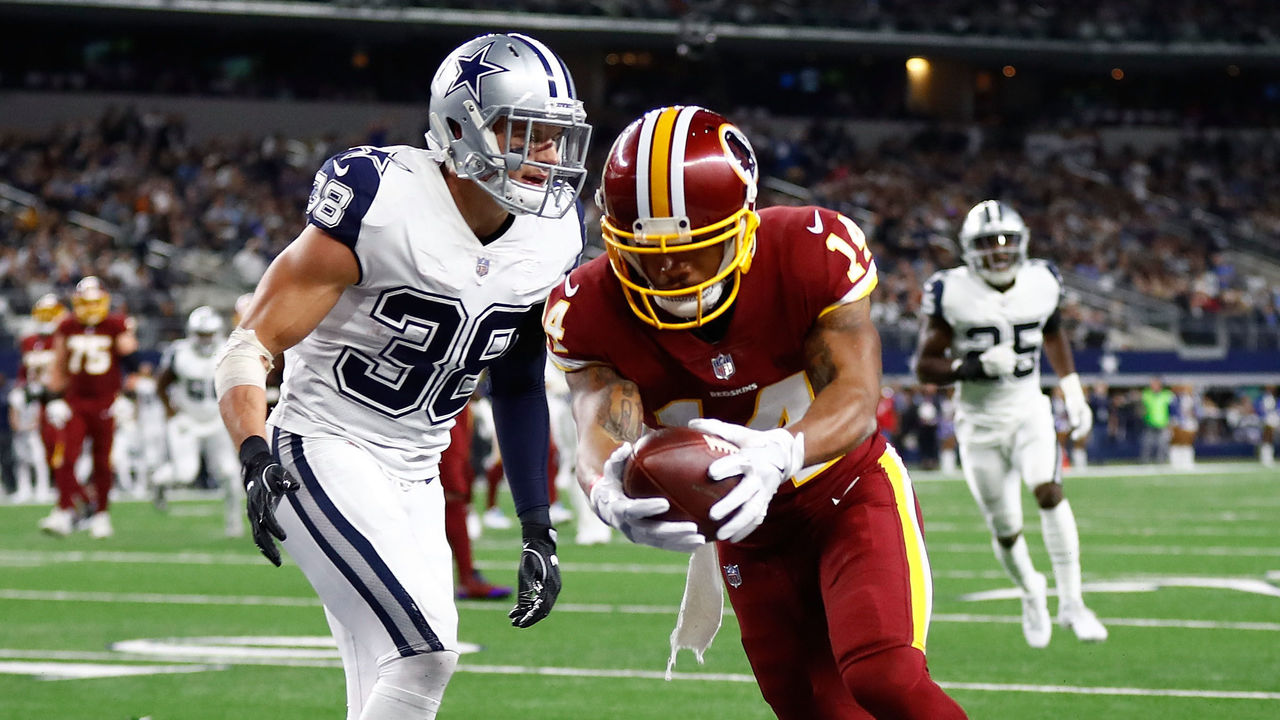 ARLINGTON, TX - NOVEMBER 30: Ryan Grant #14 of the Washington Redskins scores a touchown against Jeff Heath #38 of the Dallas Cowboys in the second quarter of a football game at AT&T Stadium on November 30, 2017 in Arlington, Texas.