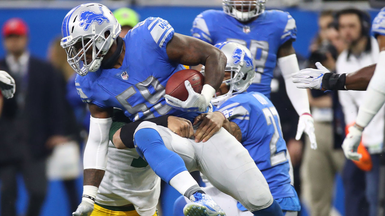 DETROIT, MI - DECEMBER 31: Tahir Whitehead #59 of the Detroit Lions recovers a fumbler by quarterback Brett Hundley #7 of the Green Bay Packers during the first half at Ford Field on December 31, 2017 in Detroit, Michigan.