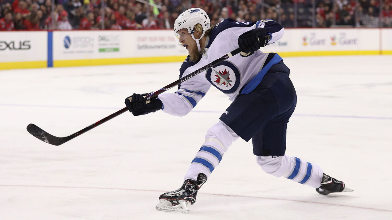 WASHINGTON, DC - MARCH 12: Patrik Laine #29 of the Winnipeg Jets shoots against the Washington Capitals during the first period at Capital One Arena on March 12, 2018 in Washington, DC.