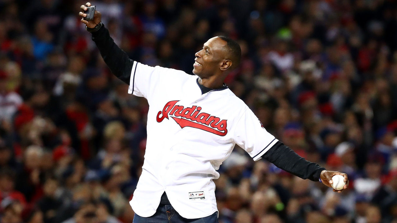 CLEVELAND, OH - OCTOBER 25: Former Cleveland Indians outfielder Kenny Lofton throws the first pitch prior to Game One of the 2016 World Series against the Chicago Cubs at Progressive Field on October 25, 2016 in Cleveland, Ohio.
