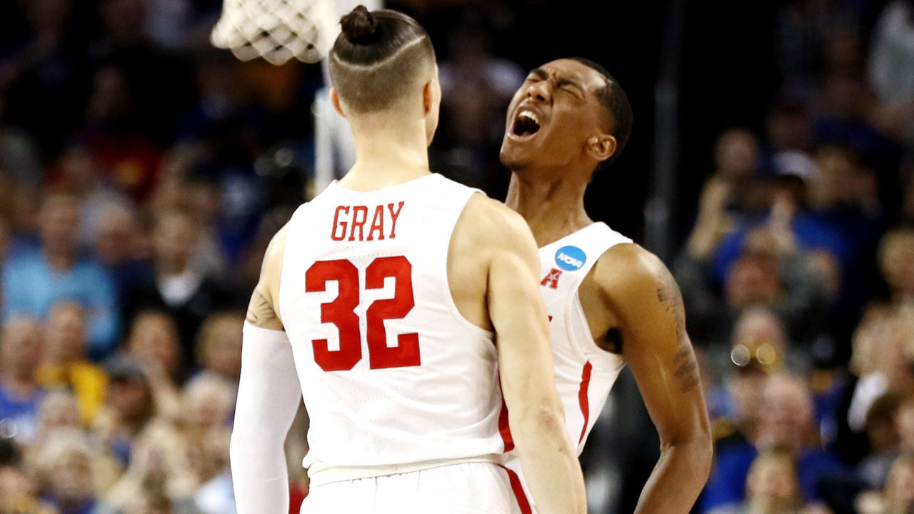 WICHITA, KS - MARCH 15: Rob Gray #32 is congratulated by his teammate Armoni Brooks #3 of the Houston Cougars after scoring the game-winning basket against the San Diego State Aztecs during the second half of the first round of the 2018 NCAA Men's Basketball Tournament at INTRUST Arena on March 15, 2018 in Wichita, Kansas. The Houston Cougars defeated the San Diego State Aztecs 67-65.