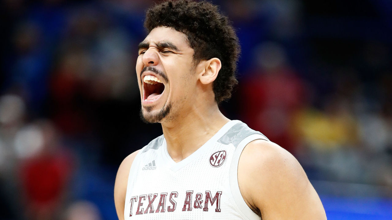 ST LOUIS, MO - MARCH 08: Tyler Davis #34 of the Texa A&M Aggies celebrates against the Alabama Crimson Tide during the second round of the 2018 SEC Basketball Tournament at Scottrade Center on March 8, 2018 in St Louis, Missouri.