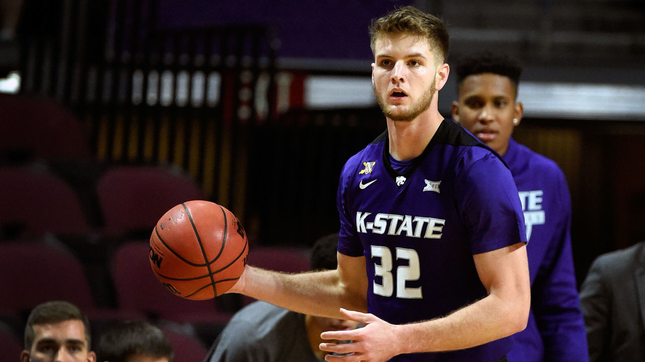 LAS VEGAS, NV - NOVEMBER 24: Dean Wade #32 of the Kansas State Wildcats looks on with the ball against the George Washington Colonials during the 2017 Continental Tire Las Vegas Invitational basketball tournament at the Orleans Arena on November 24, 2017 in Las Vegas, Nevada. Kansas State won 67-59.